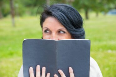 Woman trying to change - reading a book